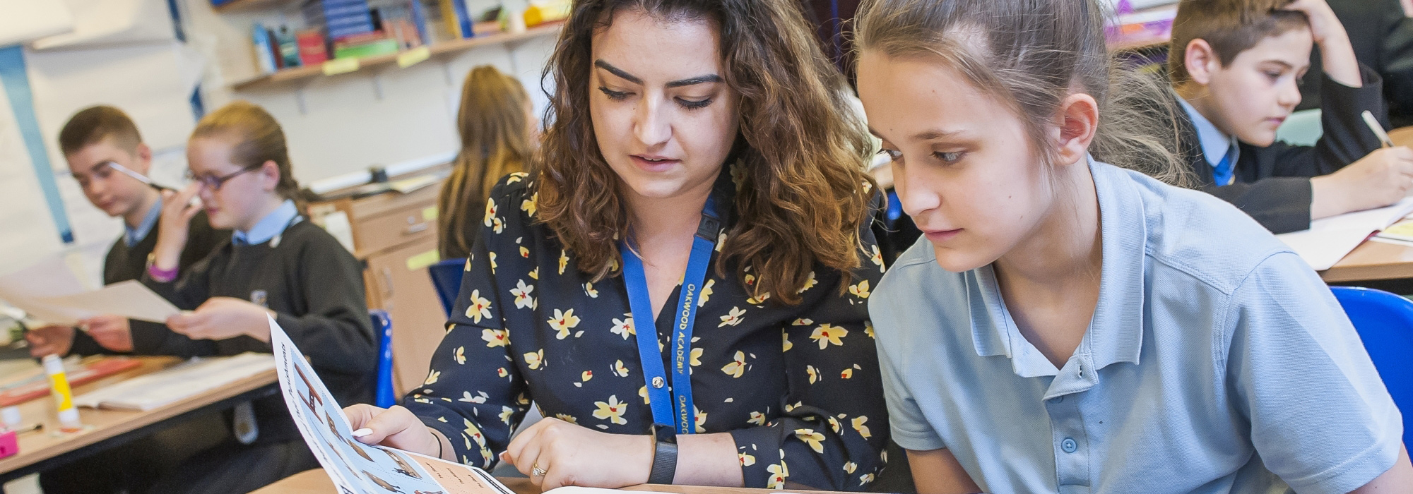 Pupil and teacher in class at Oakwood Academy