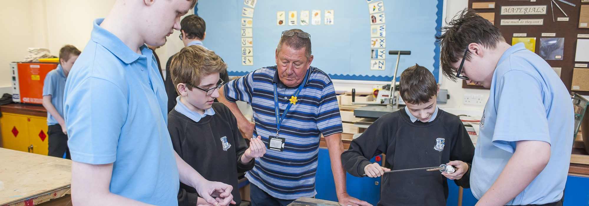 Pupils and teacher working in class